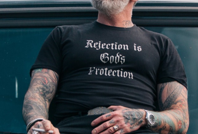 Rejection is God's Protection Statement Tee by Sheehan
