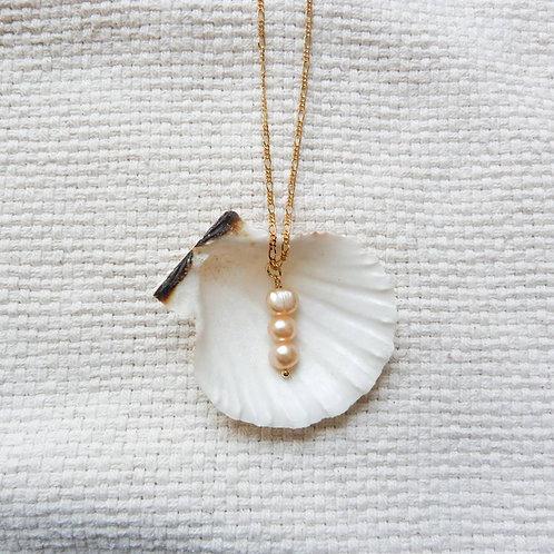 Three orange pearls necklace