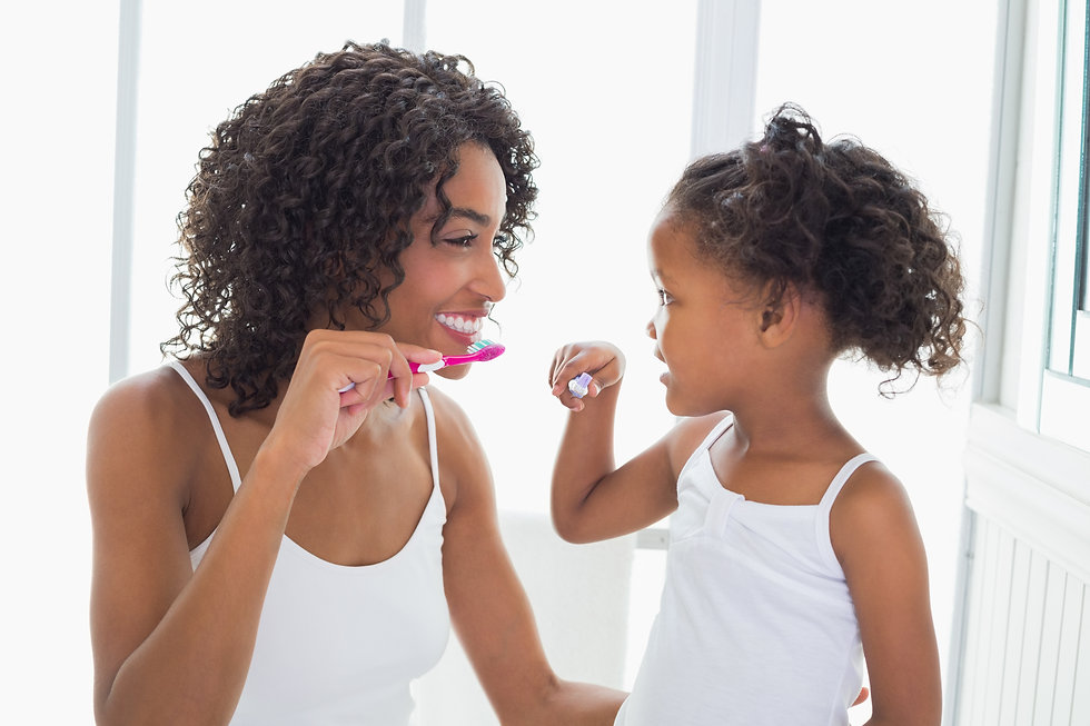 Pretty mother with her daughter brushing