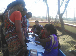 women at registration desk