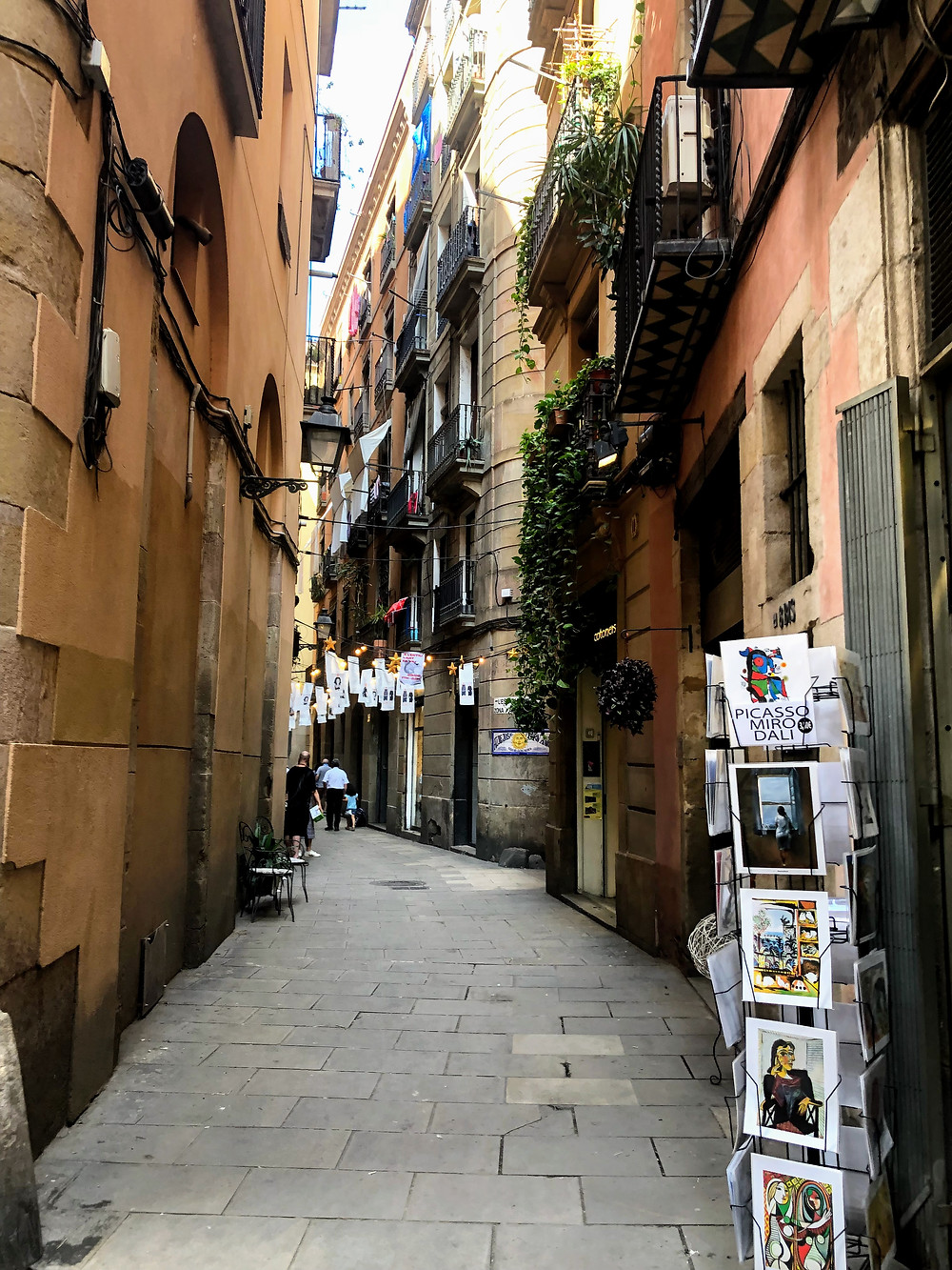 Narrow medieval street in the Gothic Quarter in Barcelona Spain