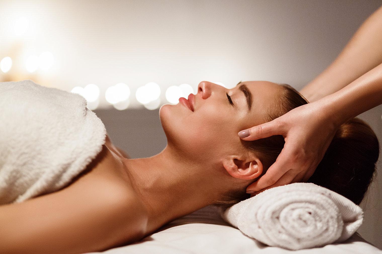 Relaxing massage. Woman receiving head m