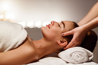 Relaxing massage. Woman receiving head m