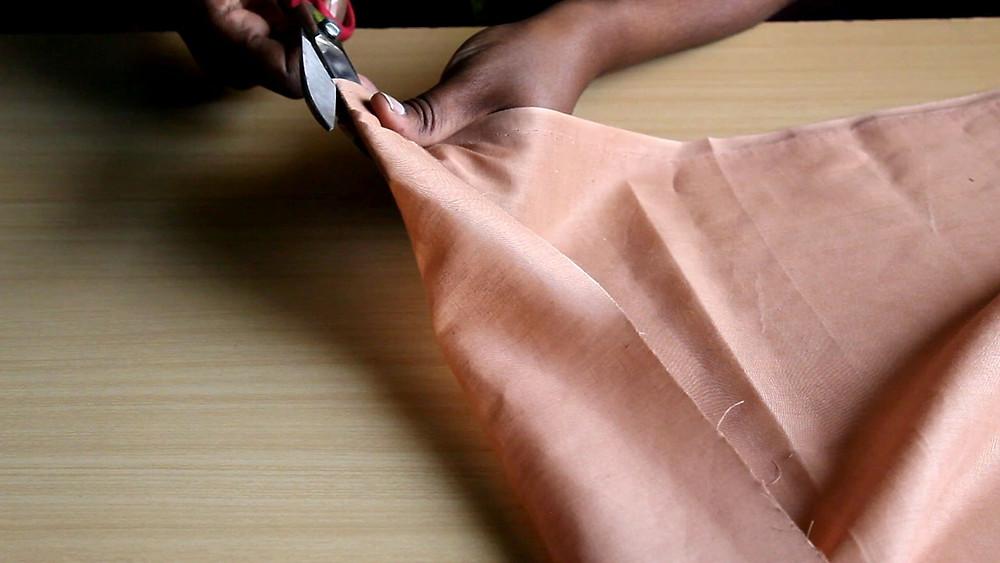 slashing fabric with scissors