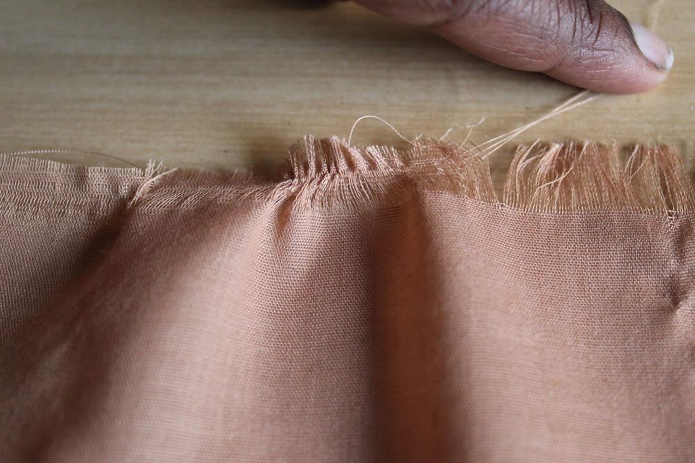 Pulling Warp threads of fabric