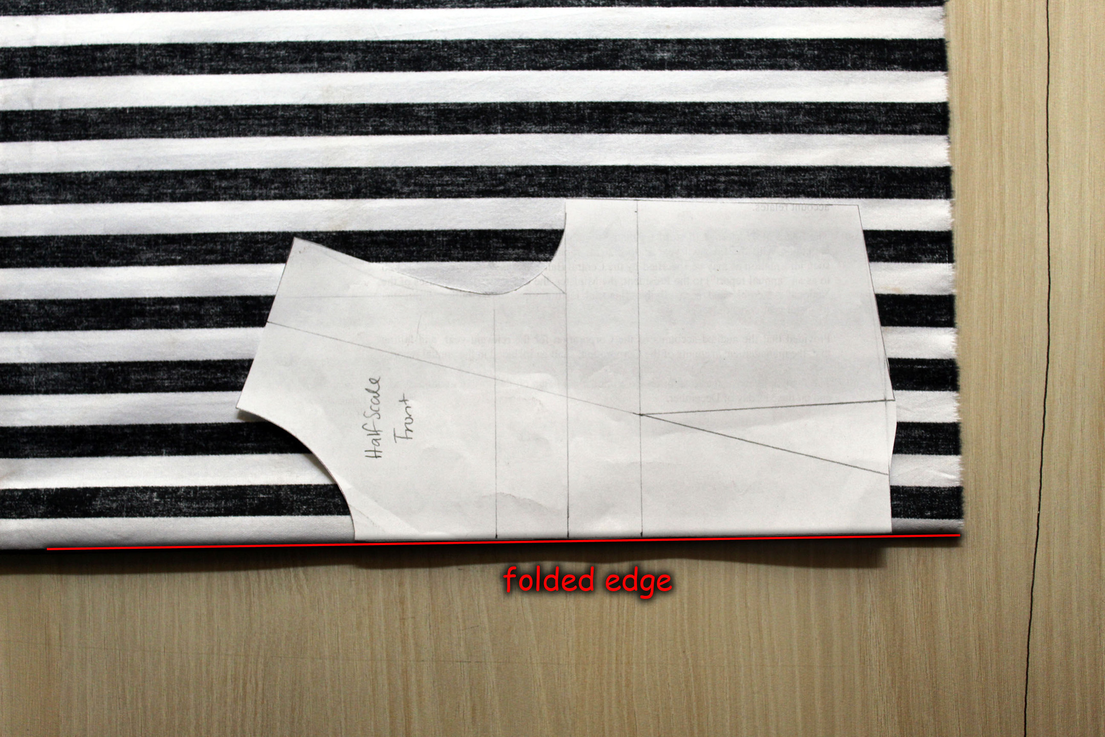pattern placed on fold of fabric