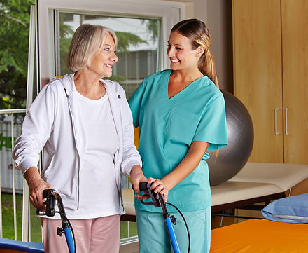 Physiotherapist helping senior woman wit