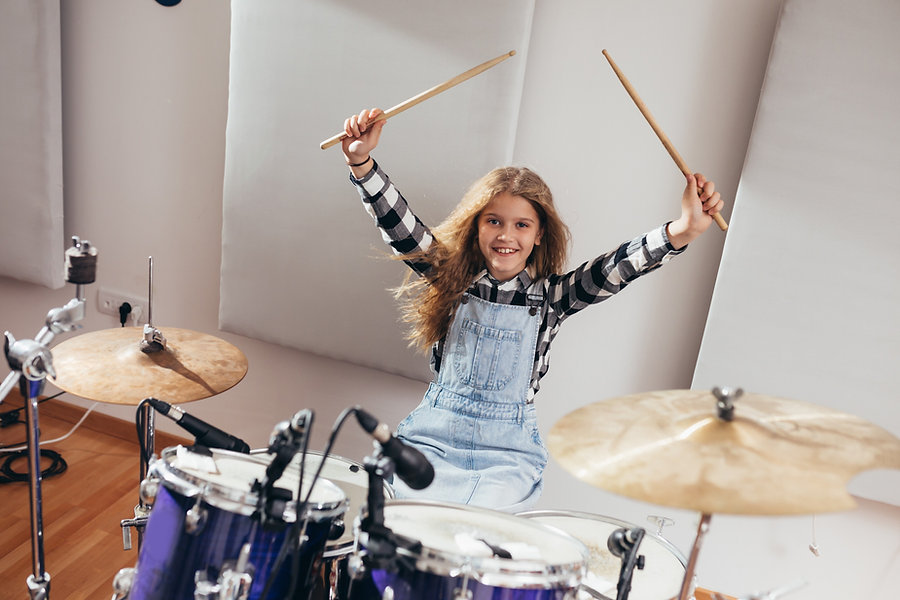 Young girl playing the drums