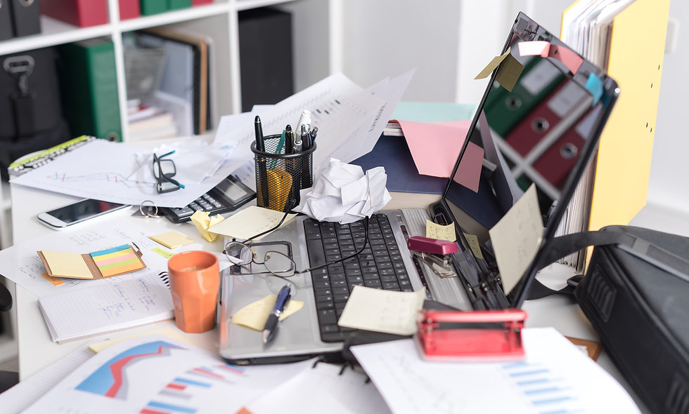 Messy and cluttered office desk.jpg