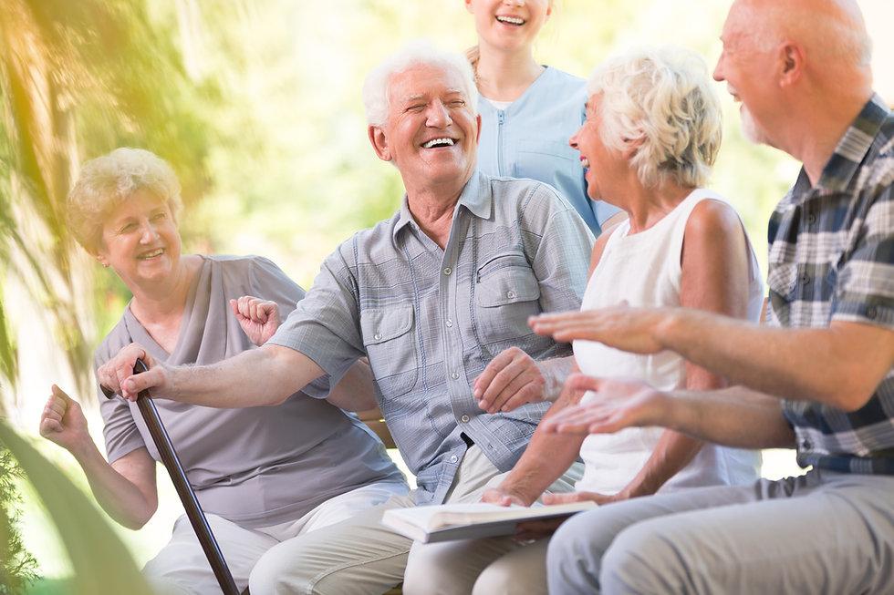 Group of smiling senior friends spending
