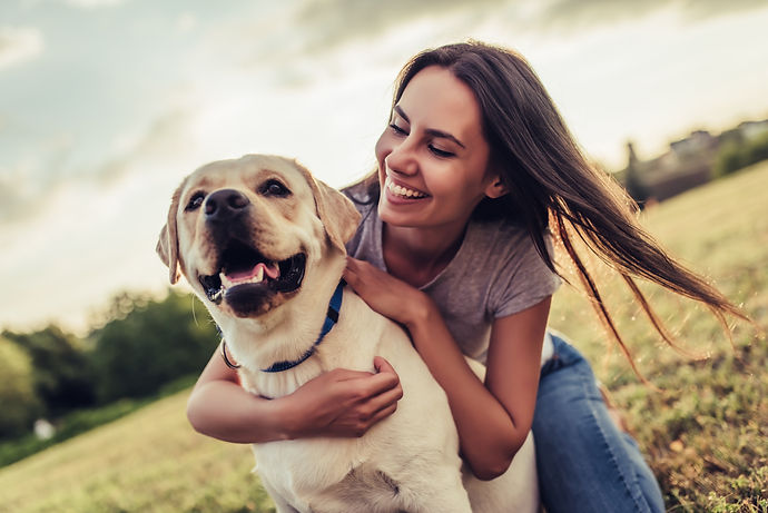 Attractive young woman with labrador out