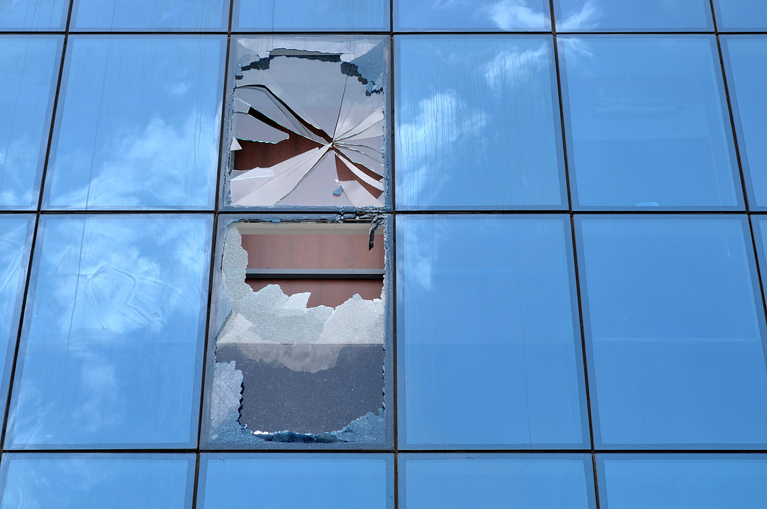Shattered glass of an office building.jp
