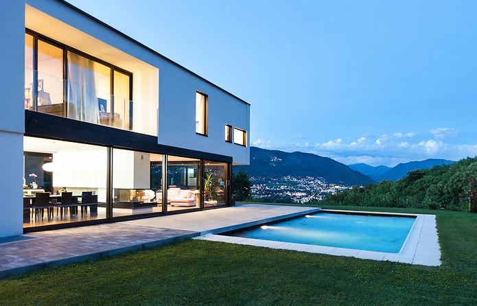 Modern villa with pool, night scene.jpg