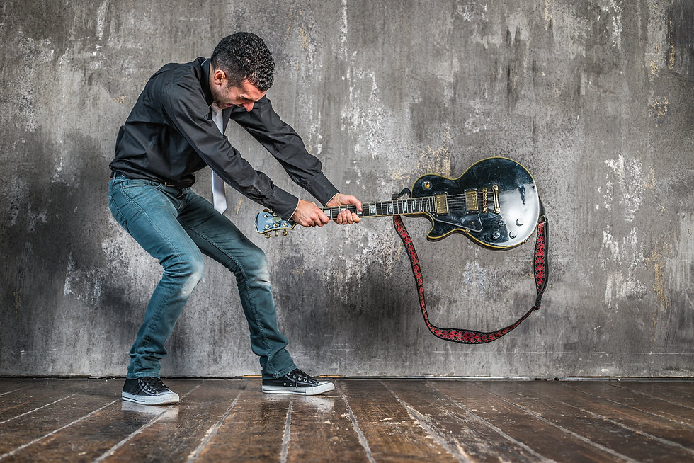 man breaking guitar on the floor.jpg