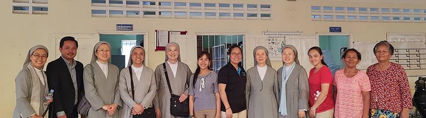 Ket with Catholic Charities Clinic Staff