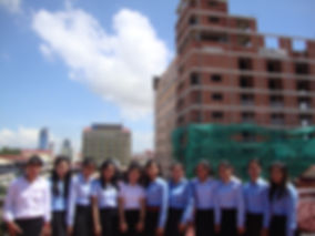 DSC01452 students with new building PP.j