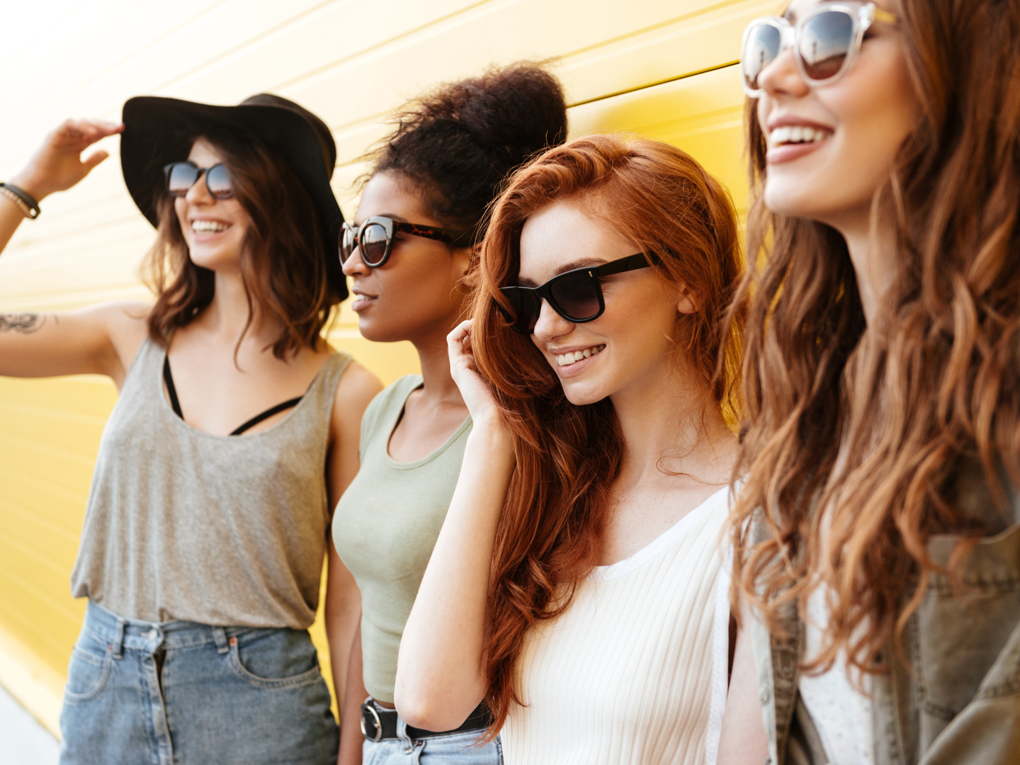 Picture of four young happy women friend