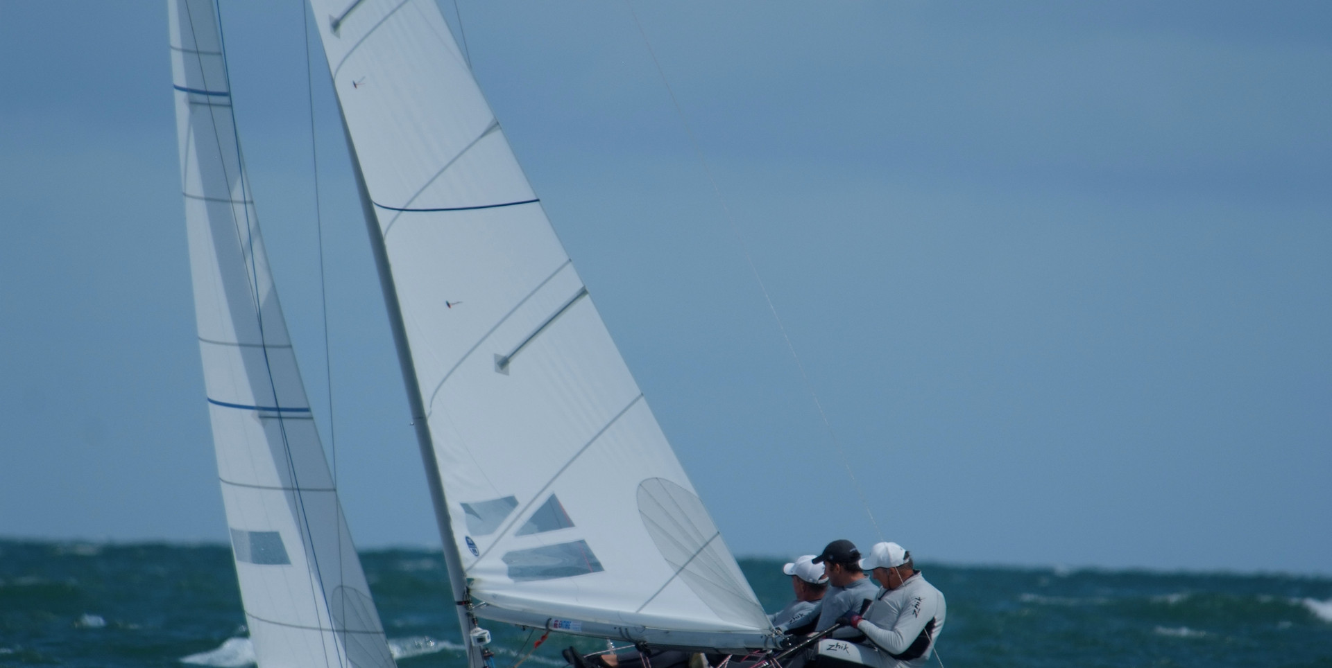 Andrew Palfrey heading upwind with John Bertrand and Ben Ainslie