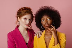 Diverse beauty, fashion_ studio portrait of two beautiful confident multiethnic women wear