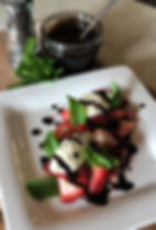 strawberries with whipped pepper chevre.