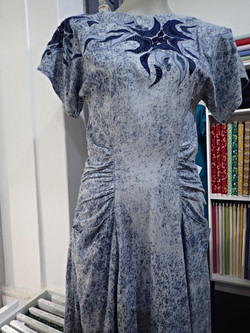 Embroidered dress with gathered side