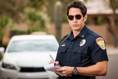cop writes ticket.jpg