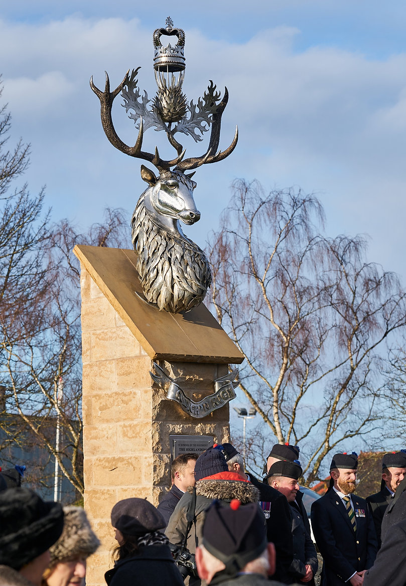 The Memorial to the Highlanders (Seaforths, Gordons, Camerons) Fochabers Moray Scotland, stainless steel sculpture representation of The Highlanders cap badge with stag, thistle and crown. Monumental sculpture. Hand beaten and welded stainless steel - artisan, arts and crafts