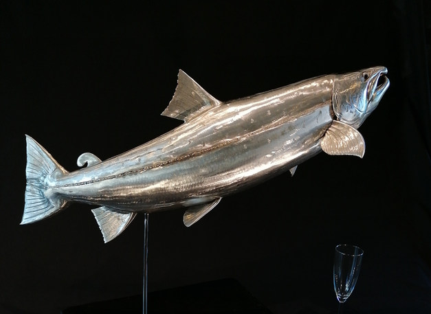 Stainless steel bespoke salmon sculpture on simple mount over polished granite base.