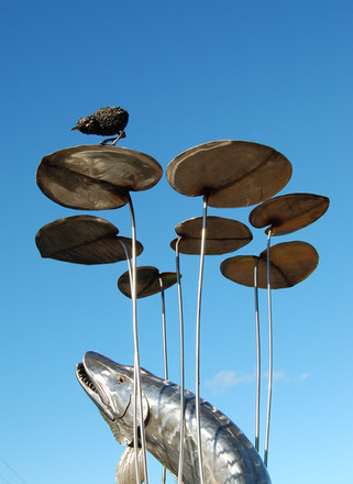 Stainless steel pike sculpture with lily pads and water rail