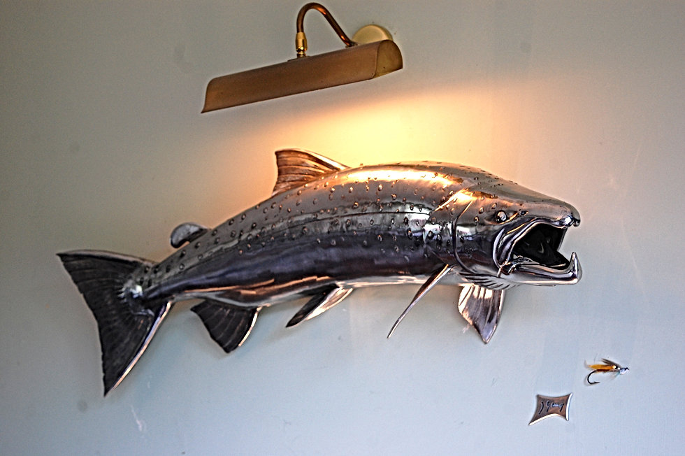 Stainless steel salmon created by Jason Sweeney Sculptor in Metal for private commission, replica of salmon caught on Holkna River, Iceland. Sculpture mounted in the lodge in Iceland where the salmon was caught.