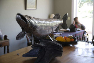 Stainless steel pike sculpture and artist Jason Sweeney
