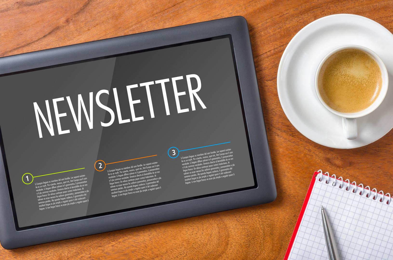 Tablet on a desk - Newsletter.jpg