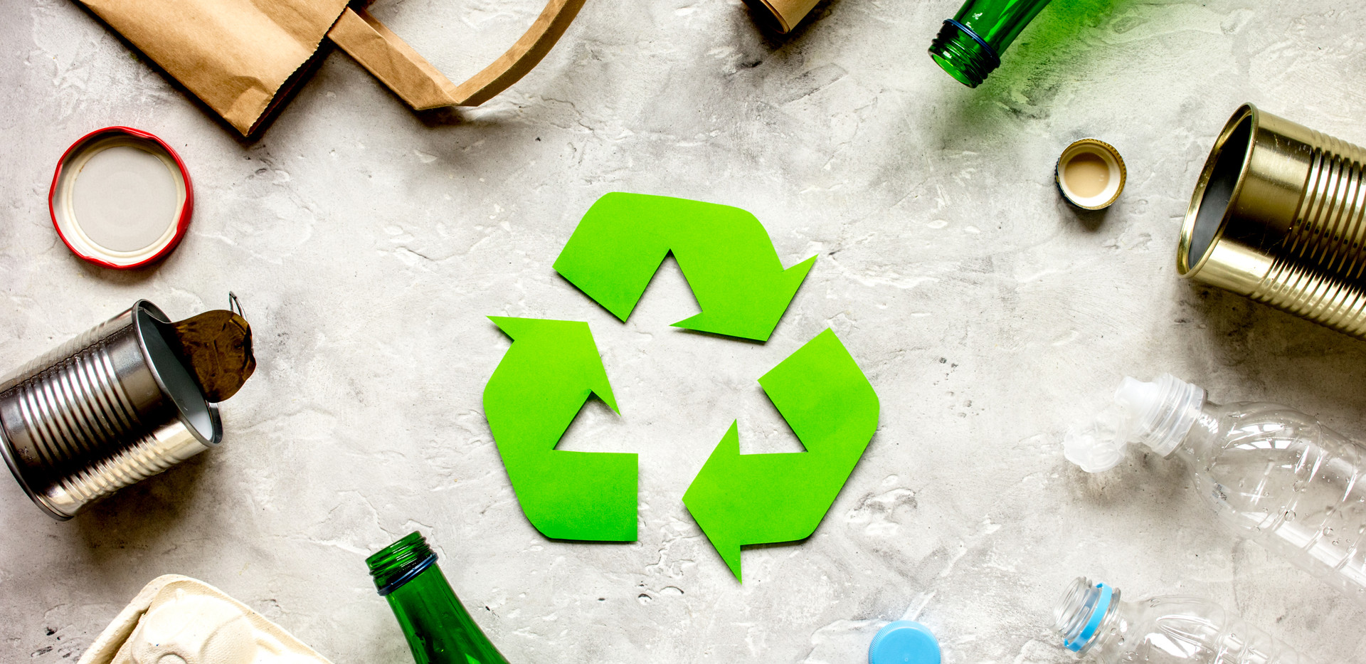 waste recycling symbol with garbage on s