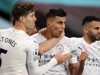 Ten-man City overcome Villa to move closer to the title