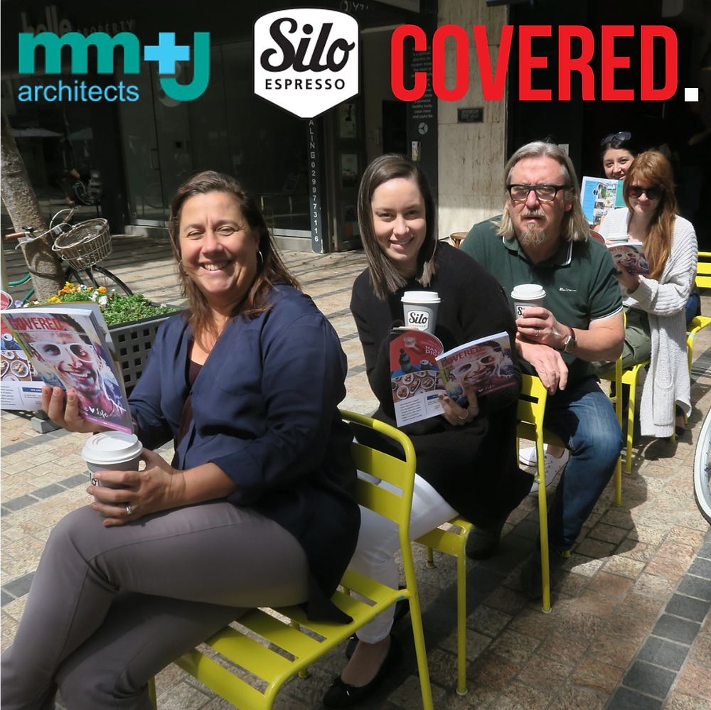 the mm+j architect team reading their copies at silo coffee in manly