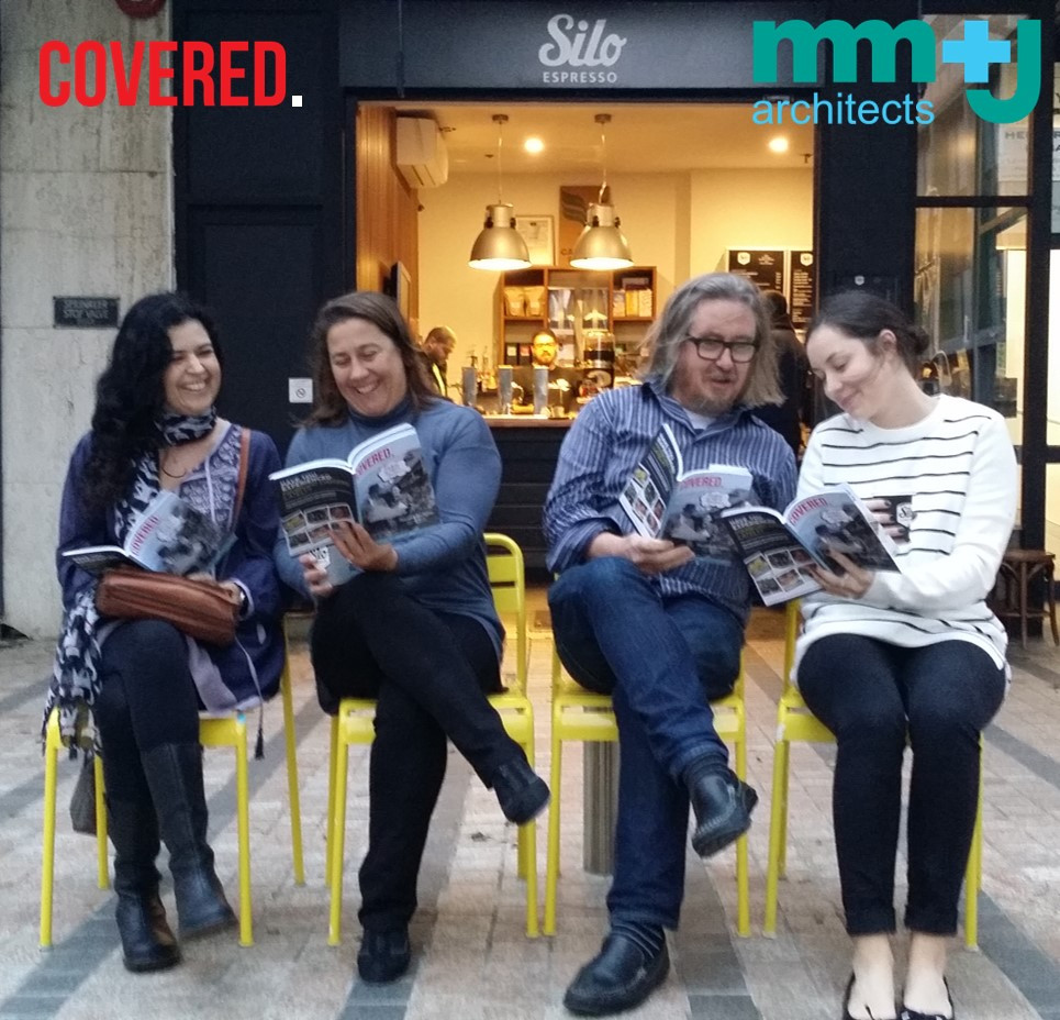 team mm+j reading the winter issue of COVERED