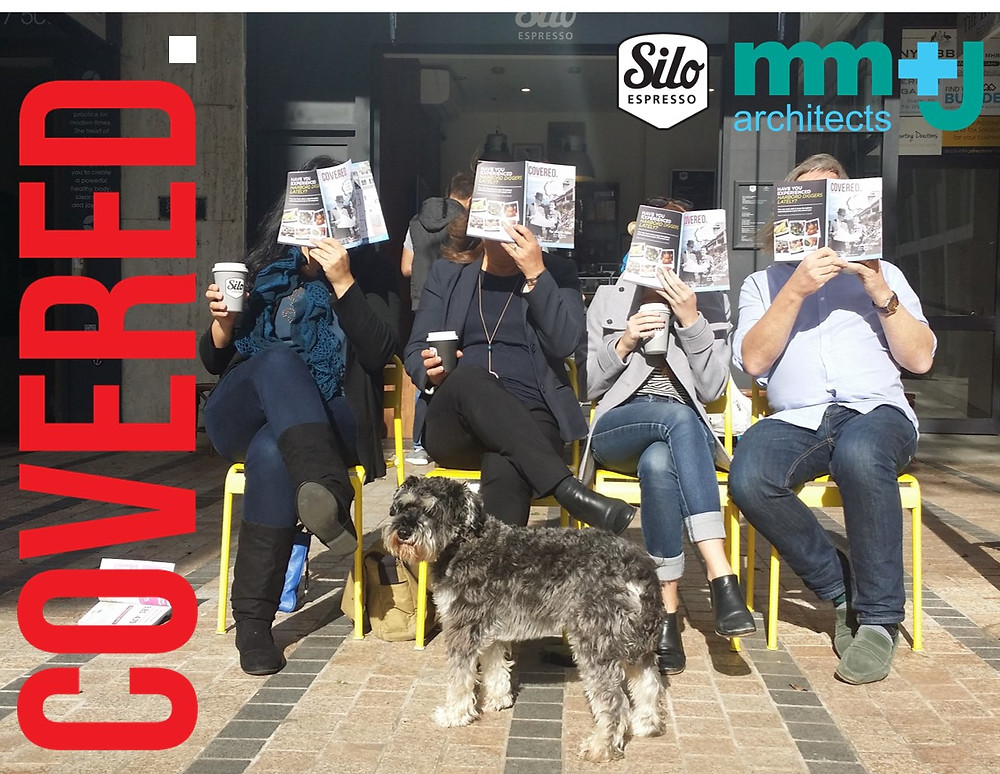 the mm+j architects team in manly reading the winter issue of covered