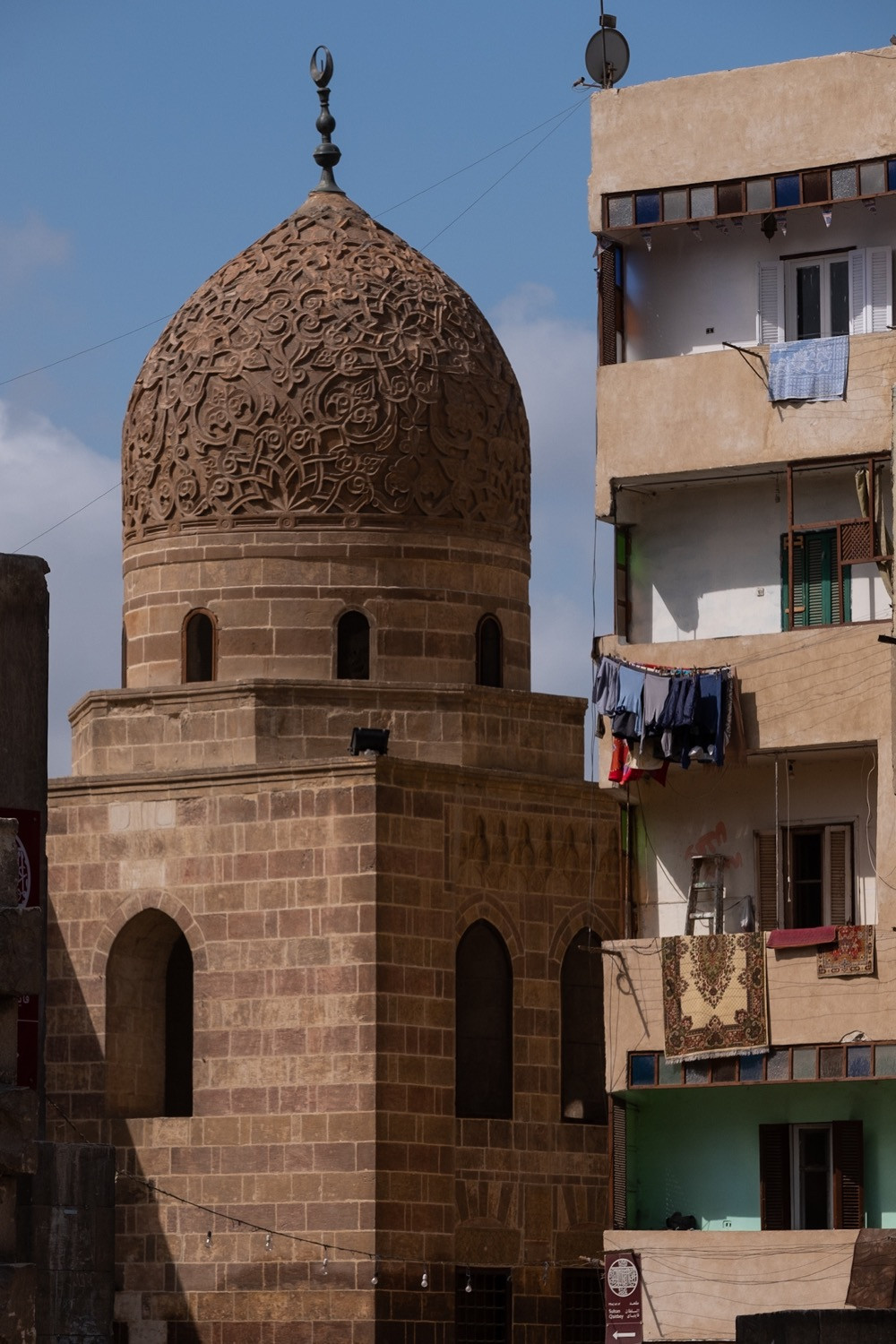 Contrast of cultures ugly building next to new one islamic old cairo photography