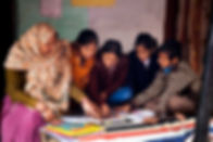049 Seema helping a bunch of children le