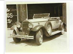 Jack's Packard with bullet holes.jpg