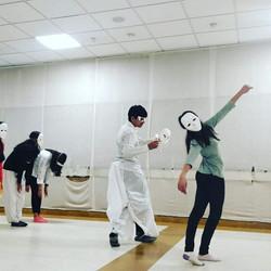 Dancing around with masks ..tasher Desh.