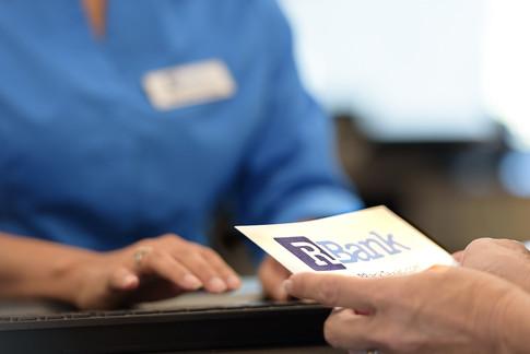 Commercial-branding-photography-bank-clerk-banker-lender-transaction-customer-service-deposit (2).jpg