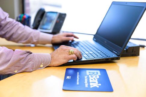Commercial-branding-photography-bank-clerk-banker-lender-laptop-ATM.jpg