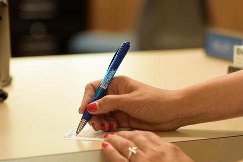 Commercial-branding-photography-bank-clerk-banker-lender-transaction-customer-service-deposit.jpg