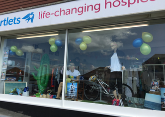 Martlets calls on the city to try a Triathlon with sporty window displays