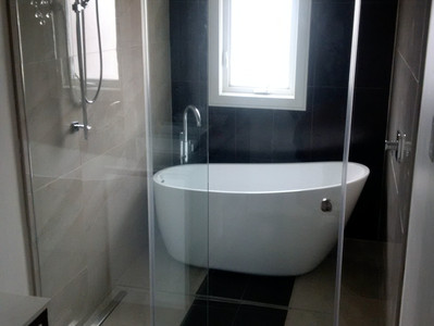 A bathroom before and after - how a contractor adds space.