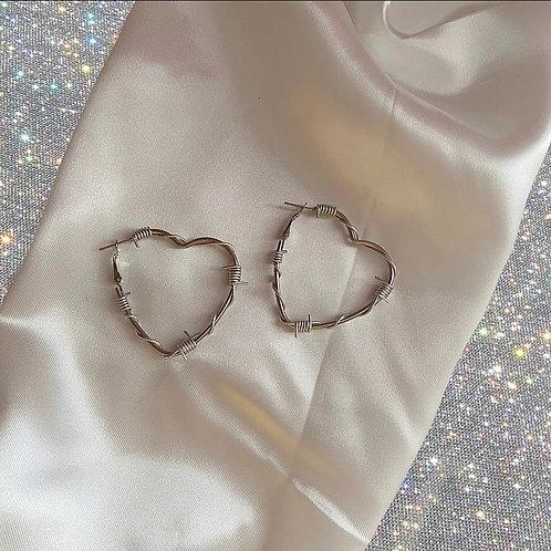 Silver barbed wire heart hoop earrings