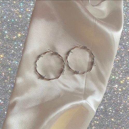 Medium silver barbed wire hoop earrings