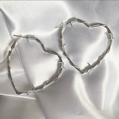Silver barbed wire heart hoop earrings