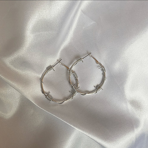 Small silver barbed wire hoop earrings